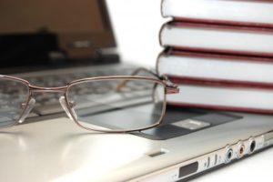 Laptop, Glasses, Books